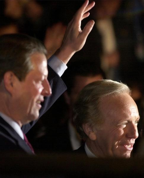 Vice President Al Gore, left, and Sen. Joseph Lieberman, D-Conn., wave to supporters outside the Eisenhower Old Executive Office Building in Washington, Wednesday, Dec. 13, 2000, after Gore gave a concession speech.