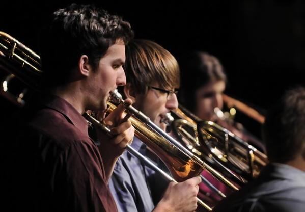 PAUL VALLEAU of Milford, left, and Evan Rzodkiewicz of Poughkeepsie, N.Y., perform seasonal songs as part of the Hartt Trombone Ensemble on Monday for a benefit concert at the Hartt School to support the Newtown community.