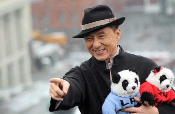 Hong Kong action film star Jackie Chan holds toy pandas as he poses for photos atop a hotel roof just outside the Kremlin in Moscow, on December 6, 2012. Jackie Chan arrived in Moscow to promote his new film 'Chinese Zodiac.'