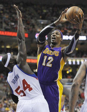Dwight Howard shoots over Sixers big man Kwame Brown