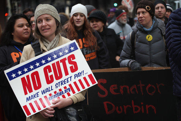 Protestors call for an increase of taxes on the wealthy and voice opposition to cuts in Social Security, Medicare, and Medicaid during a demonstration in Chicago.