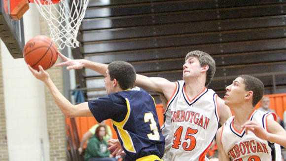 Gaylord senior Chris Stout is blocked by Cheboygan senior Jacob Schott during the Chiefs¿ 56-52 home victory Monday. Also defending for Cheboygan is senior Jordan Fontaine.
