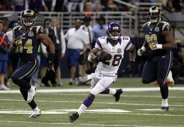 Adrian Peterson runs against the St. Louis Rams on Sunday.