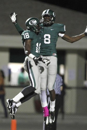 Evans' Tony Stevens (8) and Jalen Julius (18) celebrate a touchdown during a high school football game between Winter Park and Evans on Friday,  Oct.  12, 2012 in Orlando, Fla.