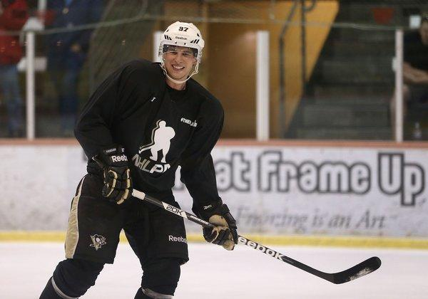 Sidney Crosby, shown during an informal workout with other locked-out NHL players earlier this month, played goalie in a rec league ball hockey game in Pittsburgh last week.