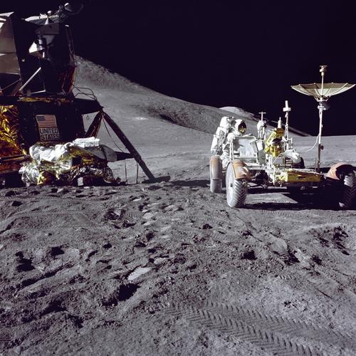 Apollo 15 lunar module pilot James B. Irwin loads up the lunar roving vehicle with tools and equipment in preparation for the first lunar extravehicular activity at the Hadley-Apennine landing site on July 31, 1971. A portion of the lunar module Falcon is on the left.
