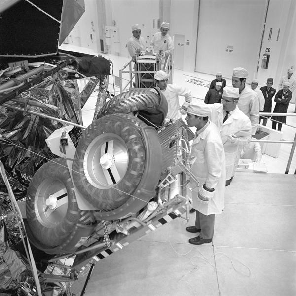 Apollo 16 Cmdr. John Young, center, and lunar module pilot Charles Duke, foreground, inspect the lunar roving vehicle at Kennedy Space Center on Nov. 12, 1971.