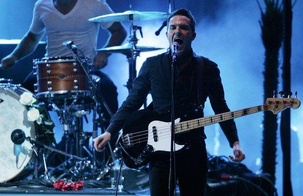 """The Killers, here performing at the Hollywood Bowl in 2009, have released a video for the song """"Here With Me"""" that was directed by Tim Burton."""