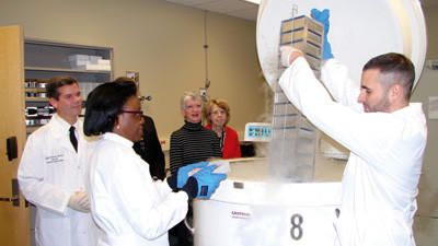 Research assistant Sean Rigby is seen holding tissue samples. Pictured from left are Col. Craig Shriver, director of the Clinical Breast Care Project; David Klementik, Windber Medical Center board chairman; Dr. Dianna Craig, surgeon and medical director of the Joyce Murtha Breast Care Center; and Barbara Cliff, center president.