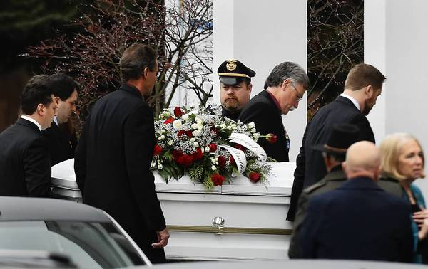The casket of Sandy Hook Elementary School shooting victim James Mattioli, 6, is carried into Saint Rose of Lima church in Newtown, Connecticut. Students returned to school in the shattered Connecticut town of Newtown on Tuesday, accompanied by police and counselors to help them cope with grief and fear after a gunman's shooting rampage killed 26 people at Sandy Hook Elementary School.