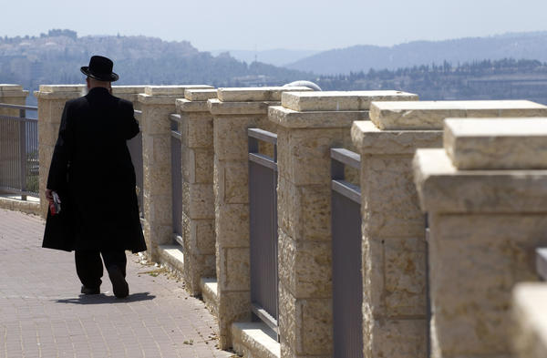 An ultra-Orthodox Jewish man walks in Ramat Shlomo, a religious Jewish settlement in an area of the West Bank annexed to Jerusalem by Israel.