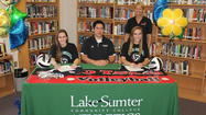 Tavares girls volleyball players Ashton Furnas and Kelsey Showalter each signed letters of intent with Lake-Sumter Community College on Monday.