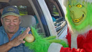 "Lou Caputo, a Florida Keys Sheriff's Office deputy who dressed as the Christmas ""Grinch,"" issued onions instead of traffic citations to motorists who slightly violated -- that's speeding no more than 5-mph over   the limit -- in Marathon, according to a news release from the Monroe County Sheriff's Office."
