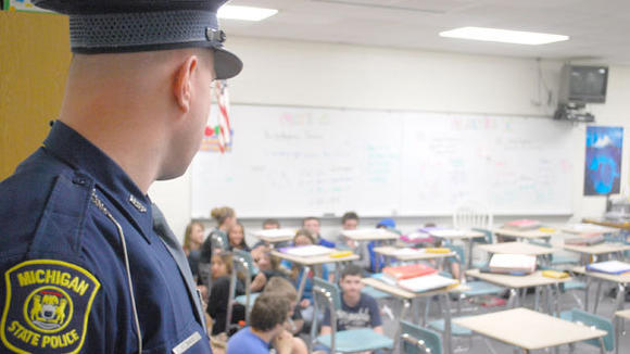 Michigan State Police trooper Kevin Baker checks on a classroom of students following a lockdown drill earlier this year at Gaylord Middle School.