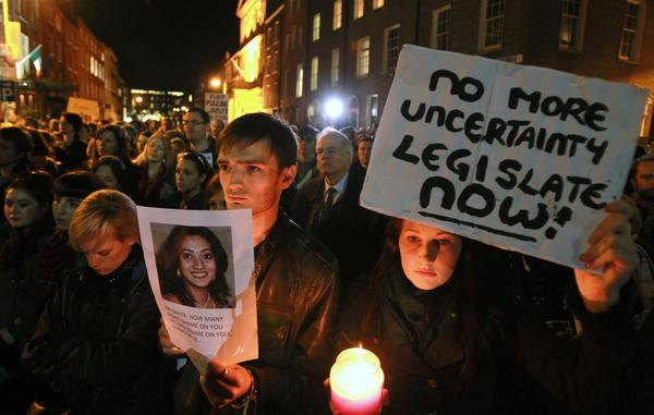 Protesters in Dublin hold pictures of Savita Halappanavar as they gather outside the Irish Parliament building Nov. 14 during a demonstration in favor of abortion legislation.