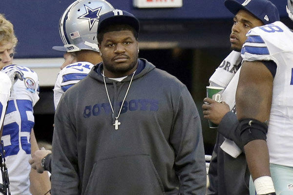 Nose tackle Josh Brent watches from the Dallas Cowboys sideline Sunday against the Pittsburgh Steelers.