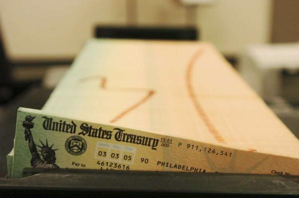 Trays of printed Social Security checks wait to be mailed from the U.S. Treasury's Financial Management services facility in Philadelphia.