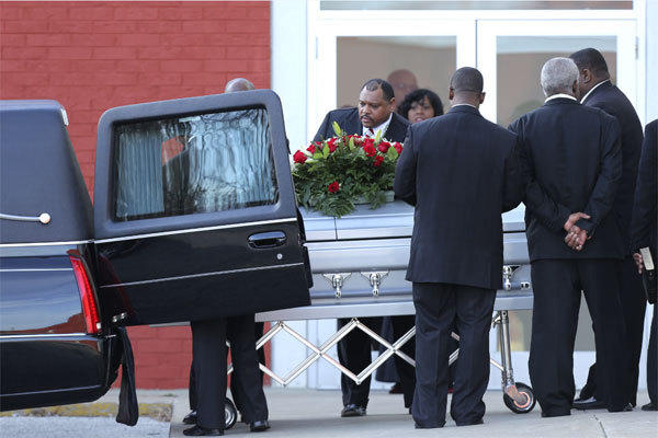 Pallbearers place a coffin with the body of Kansas City Chiefs player Jovan Belcher into a hearse after funeral services at the Landmark International Deliverance and Worship Center on Dec. 5.