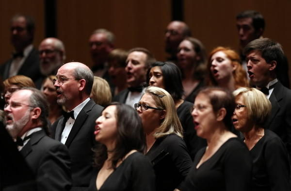 Members of Apollo Chorus of Chicago perform during Messiah at the Harris Theater for Music and Dance in Chicago on Sunday.