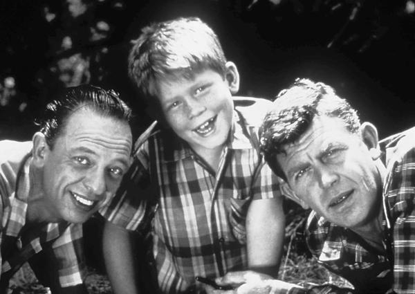 "<b>Andy Griffith</b> <br><br> Forever ingrained in America's collective TV memories as both folksy Sheriff Andy Taylor on ""The Andy Griffith Show"" and as the analytical lawyer on ""Matlock,"" Griffith was also a Grammy-winning singer and a damn fine dramatic actor (see the 1957 film ""A Face in the Crowd""). We all felt like we knew him. <br><br> <i>Griffith died July 3 from a heart attack. He was 86.</i>"