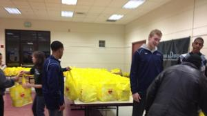 Huskies Dole Out Groceries In Hartford