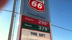 Gas prices continue to drop as holidays approach