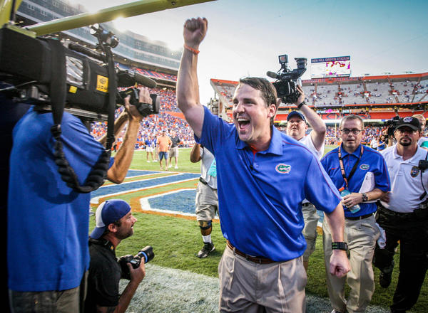 Florida coach Will Muschamp celebrates as he leaves the field after their 14-6 victory over LSU at Ben Hill Griffin Stadium on Saturday, October 06, 2012 in Gainesville, FL.