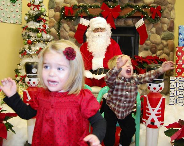 The Padar family's unconventional Santa photo, with 2-year-old twins Madeline and Charlie.