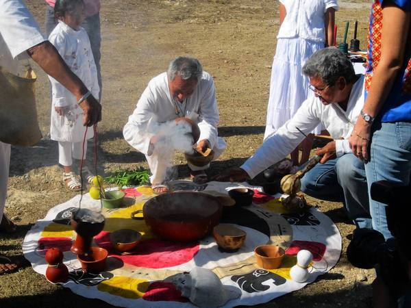 "Valerio Canche, center, president of a local association of Maya spiritual healers, presides over a ""Blessing of the Water"" ceremony near Merida, Mexico. The city is hoping interest in the Maya calendar doomsday theories will prompt people to visit the region."