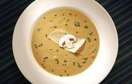 Creamy mushroom soup with roasted onion.