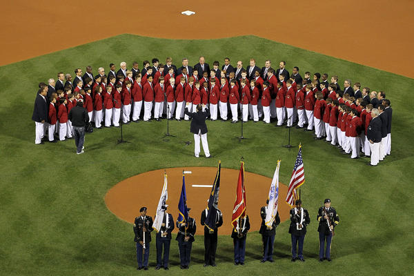 The national anthem is sung by the 'Philadelphia Boys Choir and Chorale' before Game One of the NLCS during the 2010 MLB Playoffs between the San Francisco Giants and the Philadelphia Phillies at Citizens Bank Park on October 16, 2010 in Philadelphia, Pennsylvania.