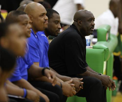 The Simeon coaching staff watches its team against Carver.