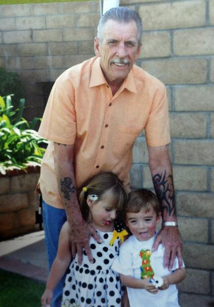 Larry Broman, shown with his grandchildren, shot himself to death in his daughter's Riverside home. He had lung cancer.