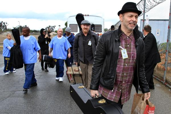 Rocker Wayne Kramer and other musicians deliver 14 new Fender guitars to inmates at the California Rehabilitation Center in Norco. Kramer's nonprofit, Jail Guitar Doors USA, has donated 150 guitars to 25 prisons across the nation.