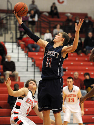 Liberty's Greg Noack (front) pulls down a rebound in front of Easton's Steve Maciejczyk (back) during their Lehigh Valley Conference boys basketball game Tuesday night.