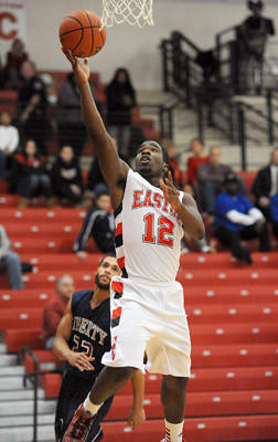 Easton's Justin Best (left) drives to the basket during their Lehigh Valley Conference boys basketball game with Liberty High School Tuesday night.