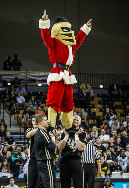 The UCF cheerleaders and mascot Knightro perform during second half action of a NCAA basketball game against the University of Miami at the UCF Arena in Orlando, Fla. on Tuesday, December 18, 2012.