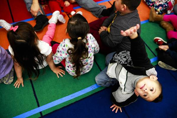Andrew Morales raises his arm during a lesson at day care at the Akitoi Learning Center in El Monte. The most severe program cuts occurred in low-income communities in south and southwest Los Angeles County, the Antelope Valley, Pomona and sections of the San Gabriel Valley.