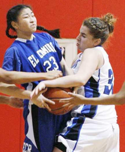 Burbank High's Courtney Seidler, right, and El Camino Real's Cora Chan battle for a loose ball.