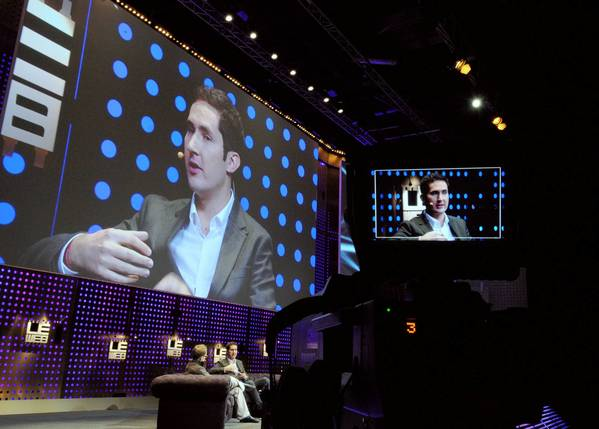 "Instagram founder Kevin Systrom, seen above at a technology conference in France this month, tried to calm the uproar caused by the firm's new terms of service. ""Instagram does not claim any ownership rights over your photos,"" he wrote in a blog post Tuesday afternoon. ""We respect that your photos are your photos. Period."""