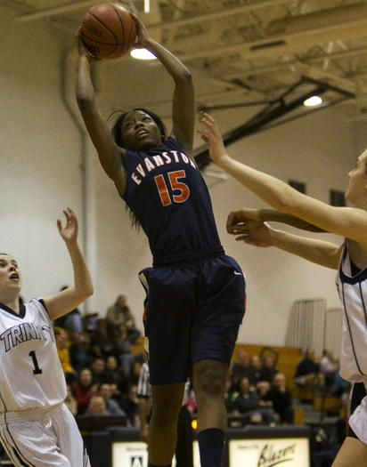 Evanston Seara Clayborn comes down with a rebound Tuesday against Trinity.