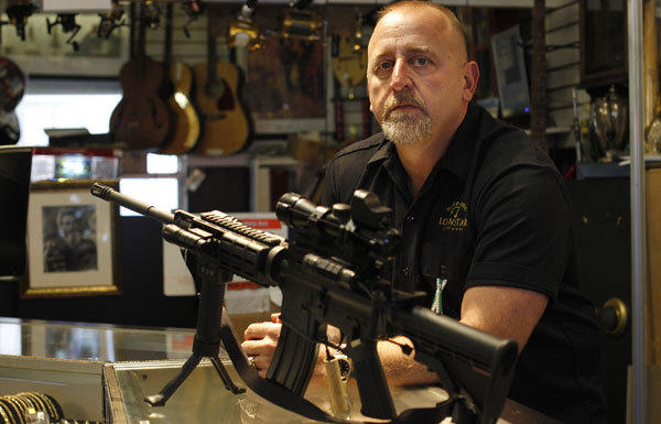 "Pawn shop owner Frank James has decided to discontinue selling all fire arms including this Bushmaster AR-15 at his shop, Loanstar Jewelry and Pawn, in Seminole, Florida. James, the father of a first grader says, ""I didn't want her thinking daddy's an evil guy, he sells guns."" Guns sales are about 50 percent of his revenue."