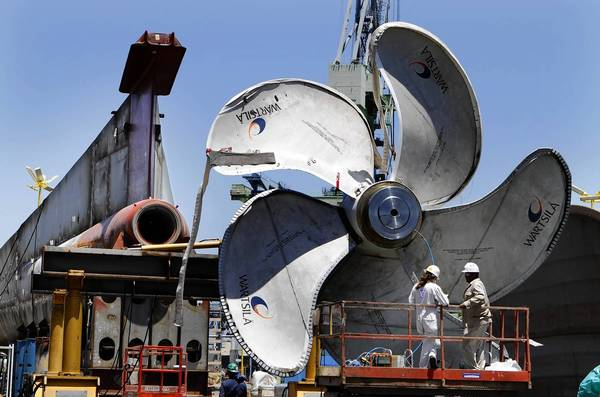 "The ""fiscal cliff"" disproportionately threatens San Diego County because the military and defense industry is responsible for 1 in 4 jobs in the area. Above, shipbuilders work on a propeller at the Nassco yard in San Diego."