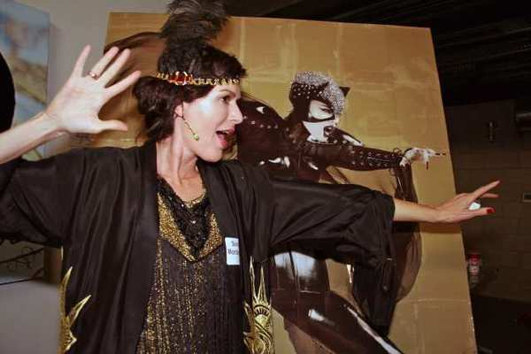 Sonia Montejano, in a '20s flapper dress, matches Catwoman at the old Seeley's Furniture Co. Bldg., scene of the Glendale Historical Society's party.