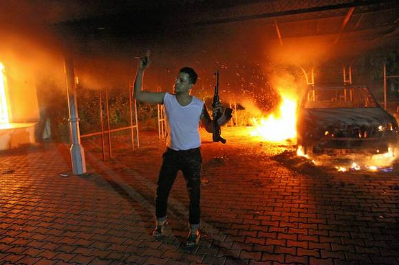 A man brandishes his weapon at U.S. mission in Benghazi, Libya, which came under attack Sept. 11
