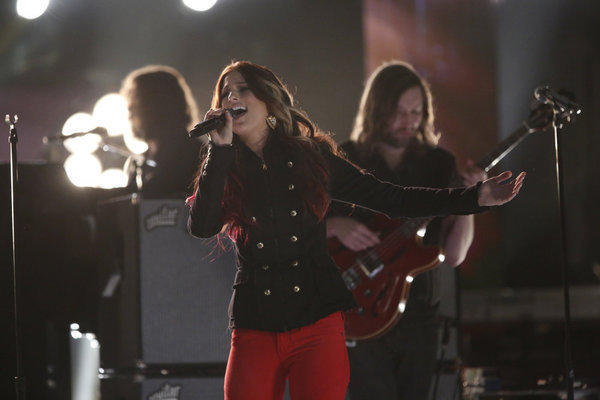 "Cassadee Pope, the Season 3 winner of ""The Voice,"" performs with the Killers on the live finale."