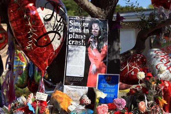 A memorial grows for singer Jenni Rivera outside her family's home in Lakewood.