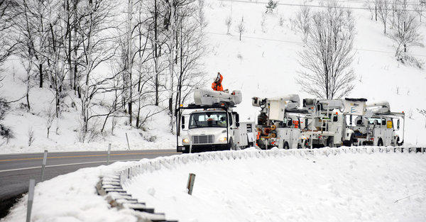 Utility crews work to restore power lines near Deep Creek Lake in Western Maryland after Superstorm Sandy dumped over two feet of snow.