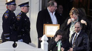 NEWTOWN, Conn. (AP) - Mourners overlapped at back-to-back services as funerals began in earnest in a Connecticut town that lost 20 of its children and seven adults to a gunman, with emotions and tempers in tatters amid a global crush of media attention to a community once known mostly for its bucolic atmosphere and sterling school system.