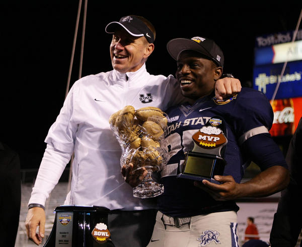 Utah State Aggies head coach Gary Andersen and running back Kerwynn Williams (R) during the awards ceremony for the Famous Idaho Potato Bowl.